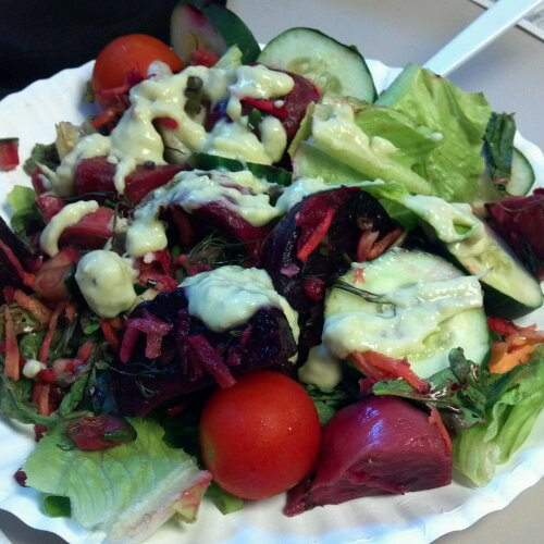 Roasted beets, cukes, lettuce, beet greens, tomatoes, carrots and homemade horseradish avocado dressing.